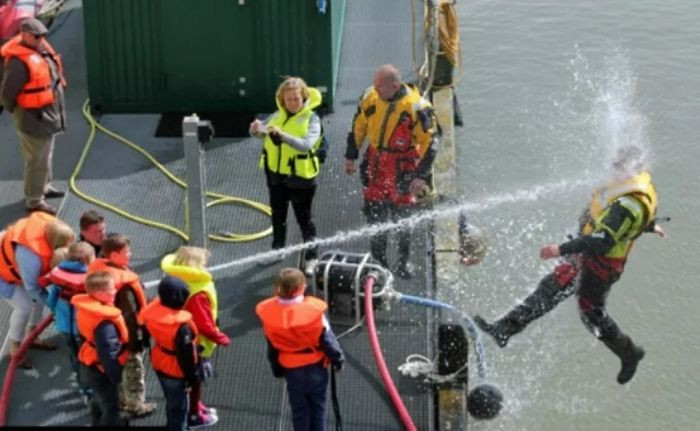 Don't play with the fire hose during Coast Guard demo