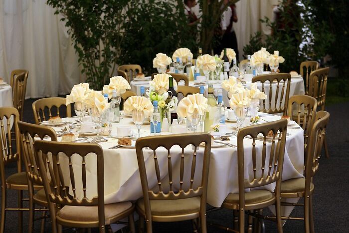 13. We took our baby to a wedding when she was 2 months old, and they had a place setting at the table for her — complete with a full set of metal cutlery and a highchair!