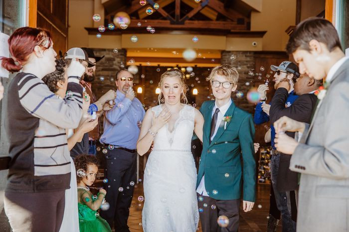A bubble flying into the brides eye makes for a great wedding photo